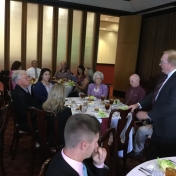 Dean Tom Erekson welcomes School of Business faculty and guests to the luncheon