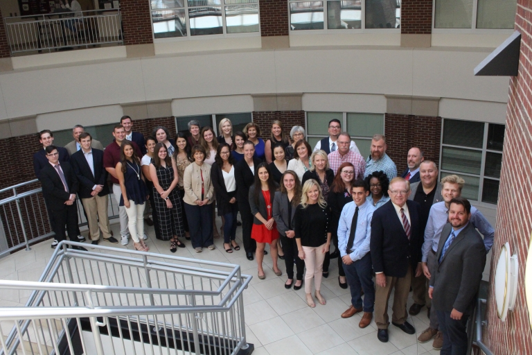 students and faculty gather for EAW luncheon