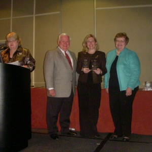 Robles (2nd from right) receives award