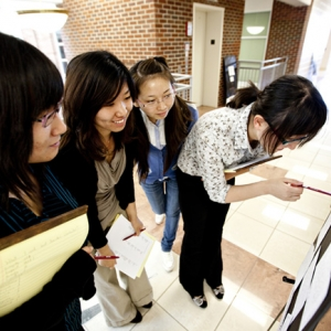 Students look over 'CharacterPostWall' for Ethics Awareness Week