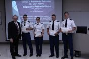 Dean Erekson (l) with 2nd Place Military Science & Leadership Team