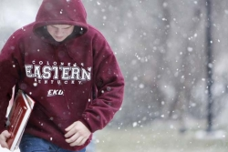Eastern student walking in the snow