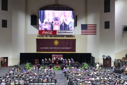 View of the coliseum floor from the back. All graduates seated.