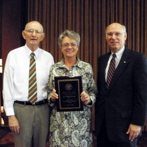 Award recipient Peggy Brewer with Jack Dyer (l) and Bob Rogow (r)