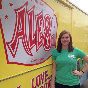 Alshey Robe poses next to an Ale 8 distribution truck