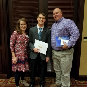 Andrew Lynch (center) with parents Christie and Travis
