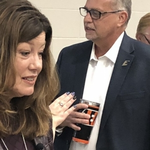 April Perry, left, chats with audience members on Oct. 24, 2018