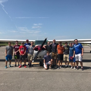 New Professional Flight students pose with EKU Top Hawk aircraft