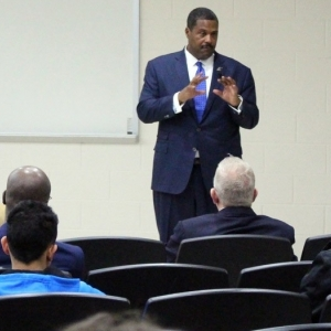 Emmanuel Bailey speaks to students at the Public Address