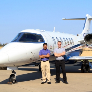 Horace Hunter and Sam Elliott in front of the Ward Kraft corporate jet