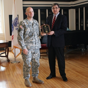 Patrick Snyder is presented the award by history professor Thomas Appleton